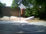 A fuller view of the half court and skateboarding area, along with the adjancent health clinic and (closed) indoor basketball court, Woodside Park, August 8, 2010 (Donald Earl Collins)