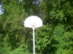 A hoop at one end of a full court, with the woods in the immediate background, Sligo Dennis Ave Park, September 23, 2010 (Donald Earl Collins)