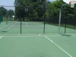 Tennis courts in background, edge of basketball court in foreground (note the fence for the tennis court and asphalt surfaces for both courts), Jessup-Blair Park, August 10, 2010 (Donald Earl Collins)