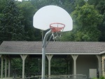 Straight-on shot of severely bent hoop and pole on one full court, Meadowbrook Park, September 17, 2010 (Donald Earl Collins)