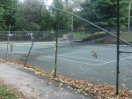 The tennis court at Woodside Park a month after a powerful storm detroyed the fence around and net in it, September 17, 2010 (Donald Earl Collins)