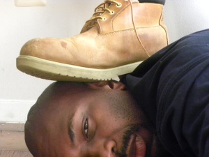 """Foot on my neck and head, symbolic of oppression in terms of view of Black and Brown as """"animals,"""" April 18, 2011. (Donald Earl Collins)."""