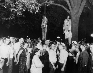 Thomas Shipp and Abram Smith, lynched in Marion, IN, August 7, 1930. (Lawrence H. Beitler). Qualifies as fair use under US Copyright laws, as It is the only image known to depict this hanging, and is used here to illustrate the event.