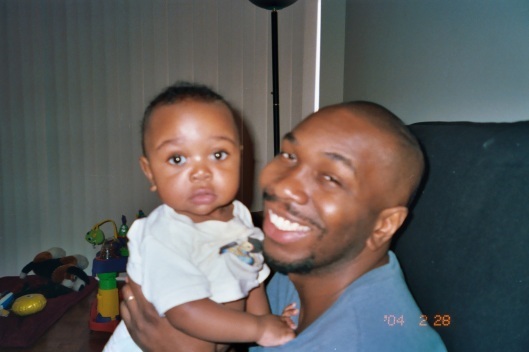 Noah with me, January 3, 2004 [he was five months old]. (Angelia N. Levy).