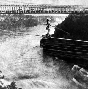 Maria Spelterini crossing Niagara Falls on tightrope with feet in peach baskets, July 4, 1876. (George E. Curtis [1830-1910] via Wikipedia). In public domain.