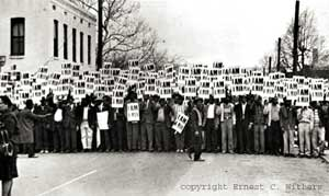 "Memphis sanitation workers' strike/march under ""I Am A Man"" picket signs, Memphis, TN, March 29, 1968. (Ernest C. Withers via http://workers.org)."