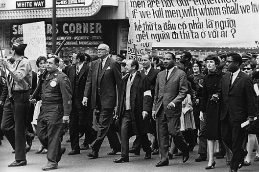 Dr. Martin Luther King and Benjamin Spock leading antiwar protest, Chicago, IL, March 25, 1967. (AP via LA Times).