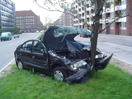 A car wreck on Jagtvej, a road in Copenhagen, Denmark, May 24, 2005. (Thue via Wikipedia). Released to public domain.