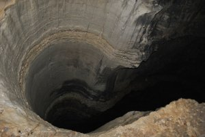 The Physics of a Bottomless Pit, February 27, 2013. (MatsuKami of deviantART via http://www.scienceblogs.com).