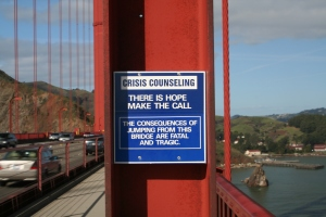The suicide prevention message on the Golden Gate Bridge (the #1 bridge in the US to jump to one's death), San Francisco CA, February 19, 2006. (David Corby/Miskatonic via Wikipedia). Released to public domain via Creative Commons.