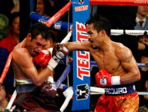 Oscar de la Hoya getting beat up by Manny Pacquiao, Las Vegas, NV, December 6, 2008. (http://beatsboxingmayhem.com).