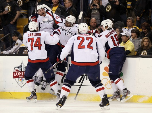 Joel Ward in celebration with Washington Capitals teammates after scoring game/series winning goal in Round 1 of Stanley Cup Playoffs against Boston Bruins (all while fans chanted racial slurs), April 26, 2012. (http://www.flightunit.com/).