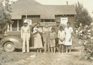 Unidentified tenant farmer, his home, automobile, and family, Lee Wilson & Company, rural Arkansas, 1940s. (http://libinfo.uark.edu/SpecialCollections/)