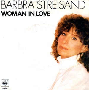 """Cover art of """"Woman In Love"""" (1980) single by Barbra Streisand, August 9, 2006. (JeanMarcDekesel via Wikipedia, http://www.discogs.com/viewimages?what=R&obid=539484). Qualifies as fair use under US copyright laws (low resolution and subject matter)."""