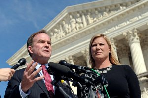 Bill Schuette, (Michigan's attorney general), with Jennifer Gratz (of Gratz v. Bollinger decision [2003] and the XIV Foundation, outside Supreme Court, Washington, DC October 2013. (Susan Walsh/AP via New York Times).