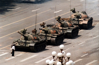 """Tank Man"" temporarily stops the advance of a column of tanks, Tianenmen Square, Beijing, China, June 5, 1989. (Jeff Widener/AP via Wikipedia)."