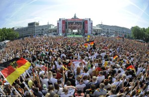 Ready and waiting: 500,000 Germany supporters await the arrival of the country's World Cup stars, Brandenburg Gate in Berlin, July 15, 2014. (AFP/Getty via http://www.dailymail.co.uk/sport/worldcup2014/).