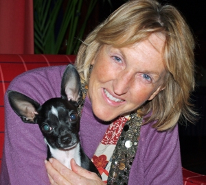 Co-founder and President of People for the Ethical Treatment of Animals Ingrid Newkirk, and David Shankbone's dog Little Man, New York City, November 1, 2007. (David Shankbone via Wikipedia). Released to public domain via CC BY-SA 3.0, GFDL.