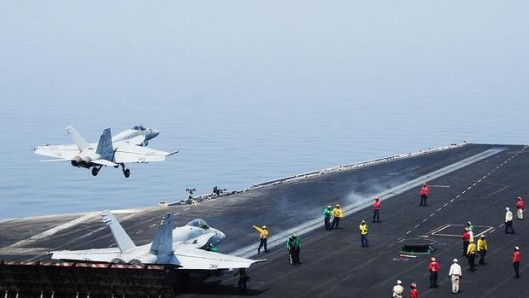 An F/A-18E Super Hornet takes off from the aircraft carrier USS George H.W. Bush in the Persian Gulf, as US air strikes in Iraq begin, August 8, 2014. (AFP/US Navy via http://images.smh.com.au/). In public domain.