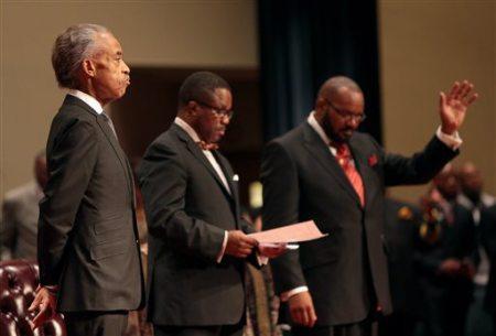 Rev. Al Sharpton waiting to speak at Michael Brown funeral, Friendly Temple Missionary Baptist Church, St. Louis, MO, August 25, 2014. (AP Photo/St. Louis Post Dispatch, Robert Cohen, via http://www.wkbn.com).