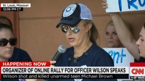 Screen shot of CNN newscast coverage of support for Officer Darren Wilson at rally, Ferguson, MO, August 23, 2014. (http://rawstory.com).