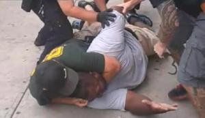 Eric Garner in midst of dying from choke-hold via NYPD's finest, Daniel Pantaleo and (not pictured)  and Justin Damico, Staten Island, NY, July 17, 2014. (http://www.thegrio.com).