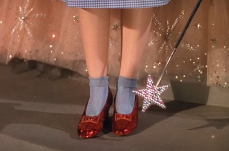 Dorothy's heel-clicking in screen shot from The Wizard of Oz (1939), August 29, 2014. (http://vivandlarry.com). Qualifies as fair use under US copyright laws - low resolution and relevance to subject matter.