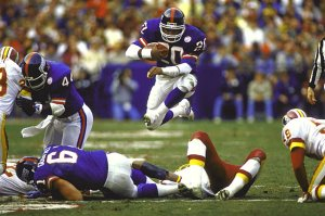 Giants' RB Joe Morris running through Deadskins again, RFK Stadium, Washington, DC, December 7, 1986. (http://sikids.com).