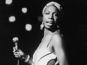 Nina Simone performs at a concert in 1964. (http://npr.org, via Hulton Archive/Stringer/Getty Images).