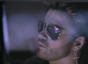 "George Michael, ""Father Figure"" video screen shot, 1988. (http://vevo.com)."