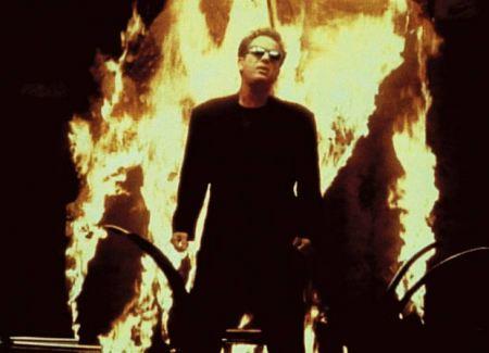 """Billy Joel, """"We Didn't Start The Fire"""" (video screen shot), 1989. (http://denverlibrary.org/)."""