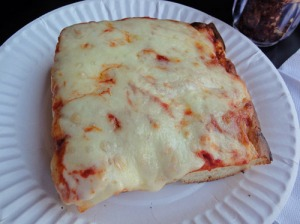 A good-looking Sicilian slice (my shop would've wrapped it in aluminum, though), November 23, 2014. (http://slice.seriouseats.com).