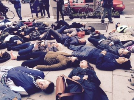 Protestors hold a die-in at 14th and I St NW, Washington, DC, November 25, 2014.  (Andrea McCarren/WUSA via http://www.wusa9.com)