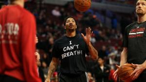 "Chicago Bulls guard Derrick Rose in pre-game warm-ups, dressed in his ""I Can't Breathe"" protest shirt, United Center, Chicago, December 6, 2014. (http://chicagotribune.com)."