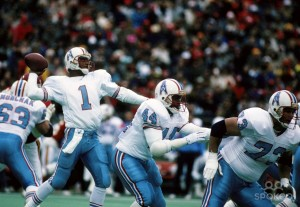 Hall-of-Fame QB Warren Moon with Houston Oilers, throwing from within pocket on his 527-yd passing day against the Kansas City Chiefs, December 16, 1990. (http://spokeo.com).
