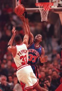 Patrick Ewing blocking a Scottie Pippen shot, United Center, Chicago, March 14, 1996. (http://chicago.cbslocal.com).