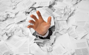 Hand reaches out from big heap of crumpled papers, January 25, 2015. (http://galleryhip.com).