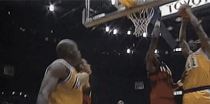 Dikembe Mutumbo putting the wood to the. LA Laker Andrew Bynum, April 14, 2015. (http://fortheloveofgif.tumblr.com).