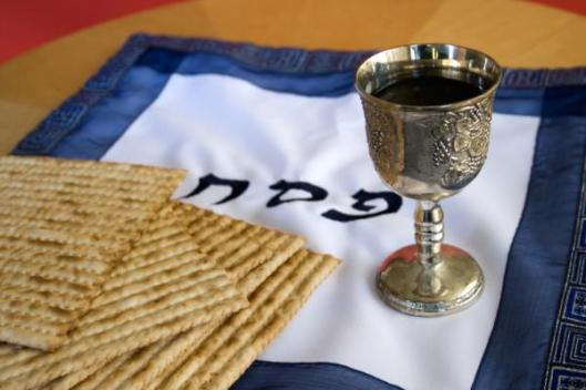 Matzo and a cup of wine in a Kiddush cup for first evening of Passover, April 7, 2015. (http://www.timeanddate.com).