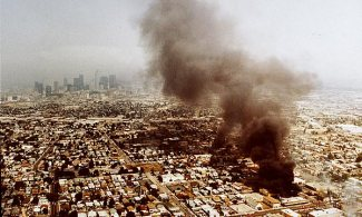 Overhead shot of L.A. riots, contrast between South Central LA fires and downtown LA smog, April 30, 1992. (http://latimes.com).