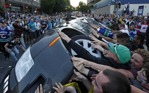 Vancouver Canucks fans riot after team's Stanley Cup Finals Game 7 defeat, June 16, 2011. (Reuters via http://theguardian.com).