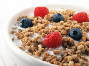 Post Grape-Nuts cereal at its visual best, with milk, raspberries and blueberries, May 6, 2015. (http://plantbasednutritionlifestyle.com/).