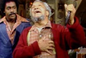Demond Harris as Lamont Sanford standing next to Redd Foxx as Fred Sanford in midst of faux heart attack, Sanford and Son (1972-77), July 8. 2015. (http://gawker.com).