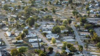 Picture of abandoned Palma Nova mobile home park, where the last of the 900 families had been evicted in 2009, Davie, Florida, February 15, 2010. (Mike Stocker/Miami Sun-Sentinel; http://www.sun-sentinel.com/local/broward/fl-palma-nova-davie-pg-photogallery.html).