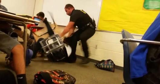 Ben Fields in midst of dragging student out of desk and throwing her across room, North Columbia, SC, October 26, 2015. (http://nydailynews.com).