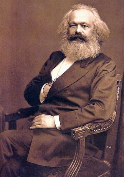 A portrait of Karl Marx, age 57, approximately August 24, 1875, by John Jabez Edwin Mayall, International Institute of Social History, Amsterdam. (Quibik via Wikipedia). In public domain.