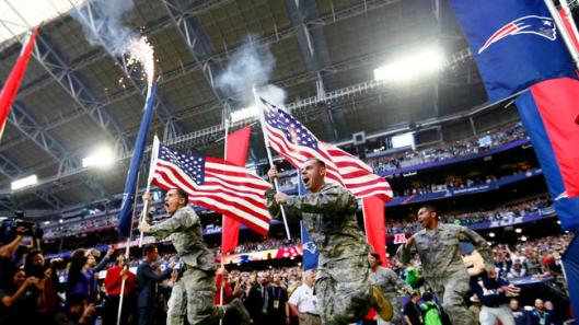 Army National Guardsmen about to run on field with American flags with the New England Patriots, Super Bowl XLIX, University of Phoenix Stadium, Glendale, AZ, February 1, 2015. (http://latimes.com; Getty Images).