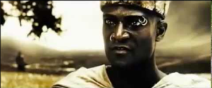"""This is madness!"" with actor Peter Mensah, screen shot from 300 (2007), November 11, 2015. (http://youtube.com)."