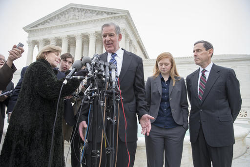 Abigail Fisher, second from right, listens as her lawyer Bert Rein, center, speaks with reporters, Supreme Court, Washington, DC, December 9, 2015. (J. Scott Applewhite/AP; http://msnbc.com).