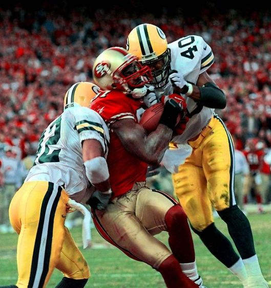 Maybe not a HOF, but a great crunch time catch (literal and figurative) by Terrell Owens, San Francisco 49ers vs. Green Bay Packers, Wildcard Game, Candlestick Park, January 3, 1999. (http://sfgate.com).